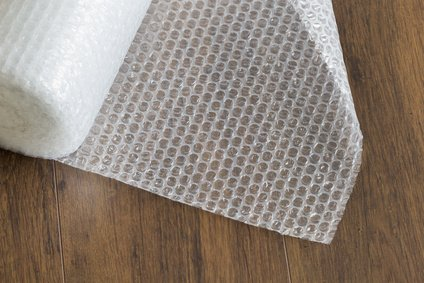 Bubble wrap roll on wooden background